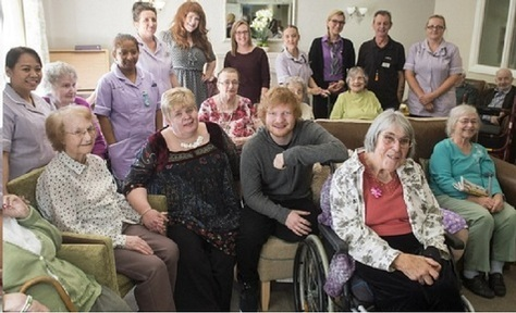 Singer Ed Sheeran with his groupies at Mills Meadow Care Home Credit: Care UK