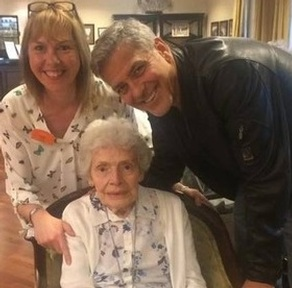Care worker Linda Jones and resident Pat Adams with George Clooney. Credit: Sunrise UK