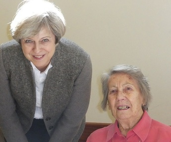Theresa May poses for a pic with Sunrise care home resident Margaret Wright Credit: Sunrise UK