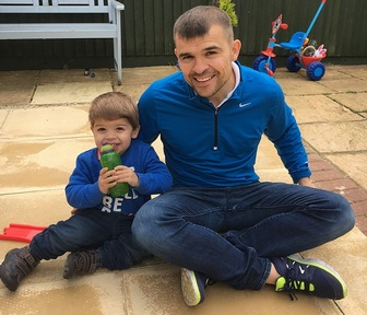 Chris Graham with his two-year-old son Dexter