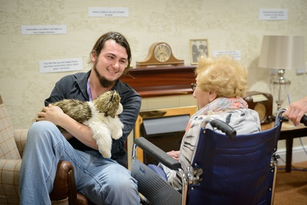 Puppeteer Ben Spooner brings cat to meet Jewish Care resident Credit: Mike Stone
